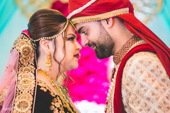 Gorgeous Indian bride and groom looking at each others eyes.
