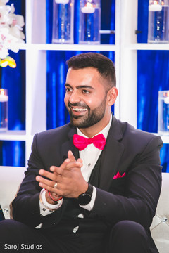 Joyful Indian groom at reception capture.