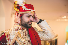 Indian groom on his wedding ceremony turban with jewelry.