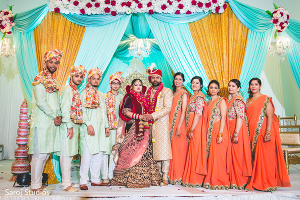 Gorgeous indian bride and groom with bridesmaids and groomsmen.