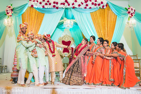 Indian lovebirds joyful moments with bridesmaids and groomsmen.