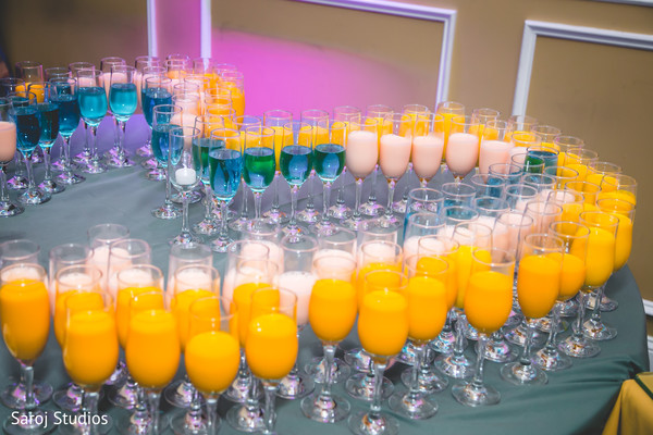 Colorful Indian wedding drinks decor.