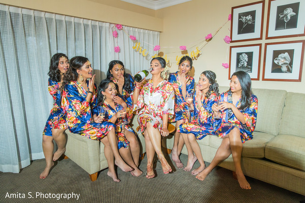 Beautiful shot of lovely bridesmaids getting ready with the maharani