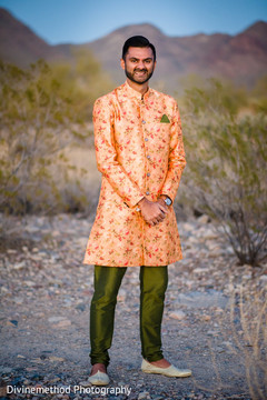 Indian groom posing for pictures outdoors