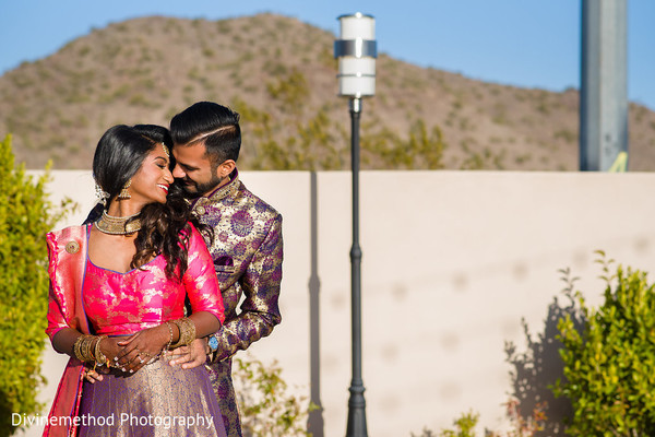 Indian bride and groom hugging each other portrait.