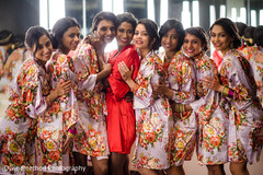 Indian bride with beautiful bridesmaids getting ready