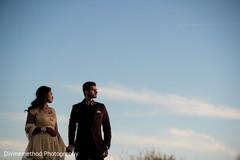 Indian newlyweds walking outside