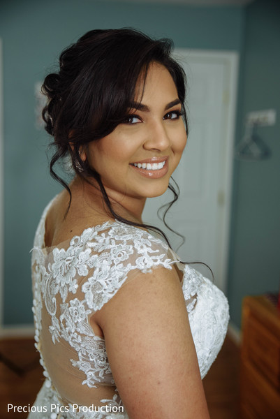 Indian bride glowing in her wedding makeup.