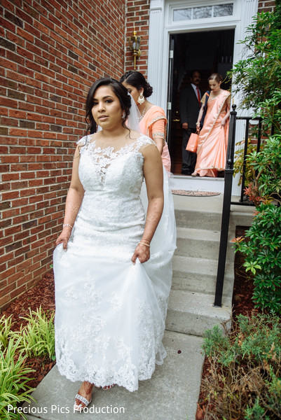 Adorable Indian bride on her way to wedding ceremony.