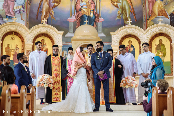 Dazzling indian lovebirds with priests capture.
