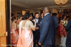 Joyful Indian bridesmaids and groomsmen capture.