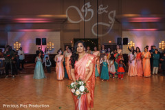Indian bride about to throw the bouquet.