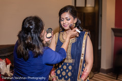 Indian bride being dolled up for the reception