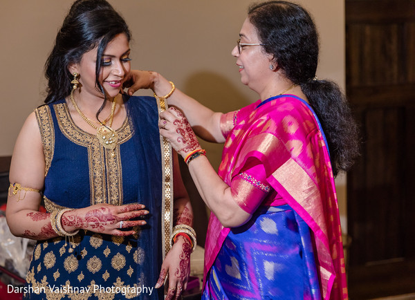 Special guest assisting the maharani with the lengha
