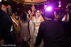 Maharani showing her mehndi design while dancing at the reception
