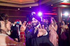 Indian groom having a blast during the ceremony