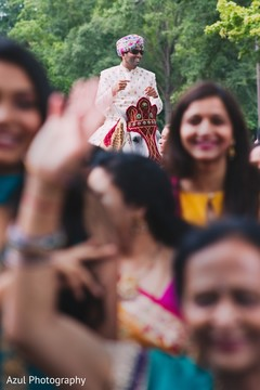 Gorgeous Indian groom on a white baraat horse capture.