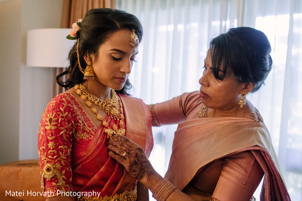 Sweet indian bride getting her jewelry on.
