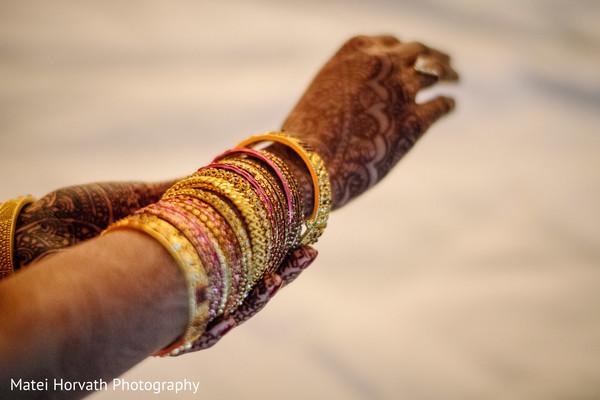 Elegant Indian bride bangles and mehndi art.
