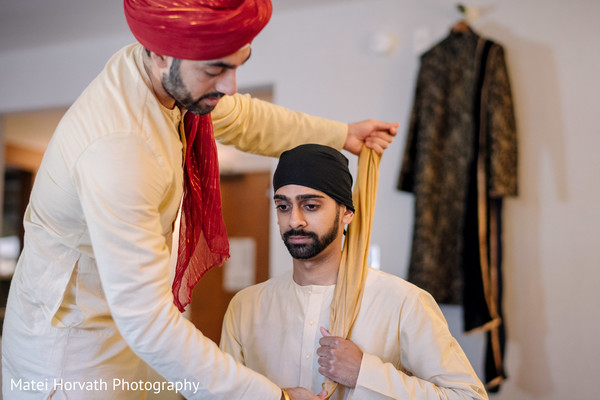 indian groom getting his pagdi on.