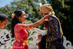 Indian bride  putting flower garland to groom.