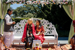 Indian bride and groom in front of sacred fire.