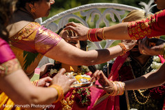 Indian bride and groom getting the Pithi.