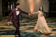 Adorable indian newlyweds making their entrance.