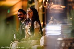 Cheerful Indian wedding reception capture.