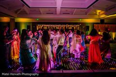 Magical Indian wedding reception dance floor capture.