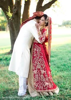 Raja hugging the beautiful maharani outdoors