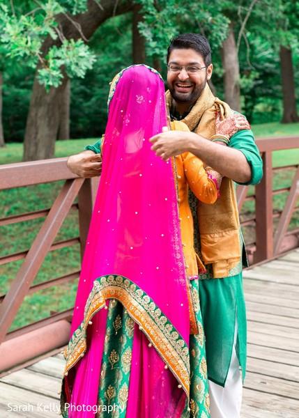 Cheerful raja hugging the beautiful Indian bride