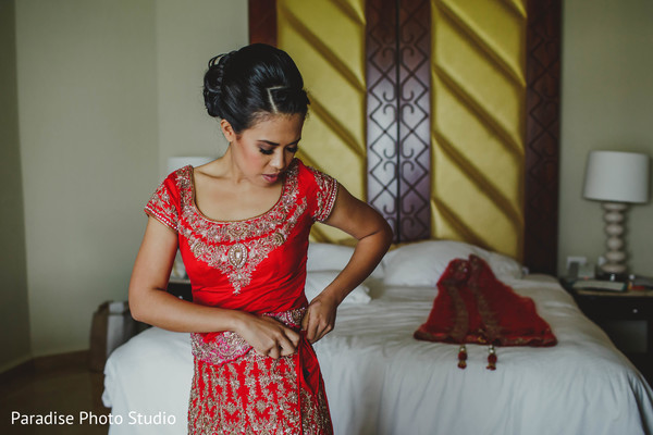 Beautiful indian bride getting ready.