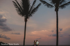 Stunning capture of indian bride and groom by the beach.