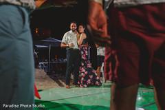Indian bride and groom at their sangeet dance floor.