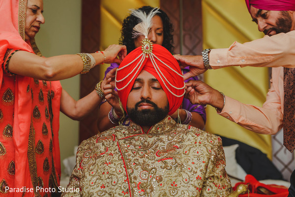 Indian groom on his wedding ceremony turban with jewelry.