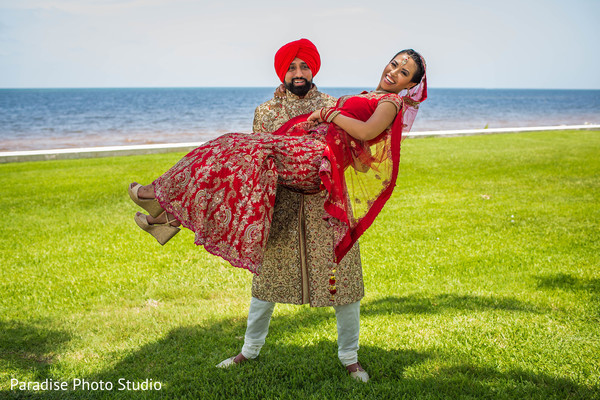 Lovely Indian couple on their ceremony wedding outfits.