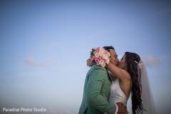 Enchanting kiss of Indian couple.
