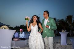 Elegant Indian bride and groom at reception capture.