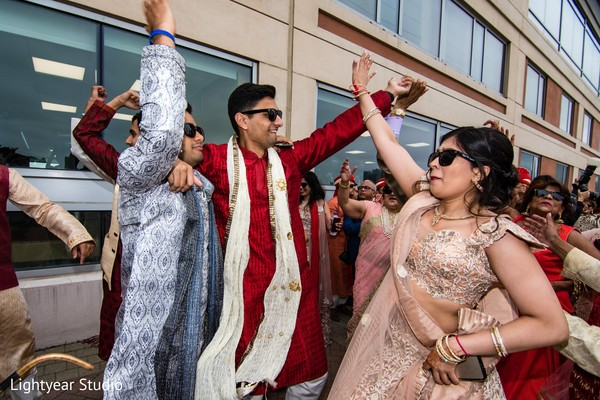 Indian wedding guests having a blast during the baraat