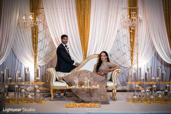 Maharani and Raja posing with their reception attire