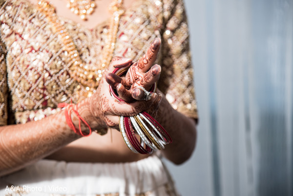 Indian bride putting on her bangles