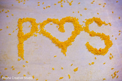 Indian couple initials made with rice