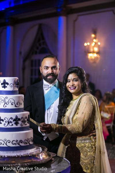 Indian wedding reception cutting the cake scene