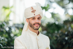 Elegant Indian groom's on his wedding outfit.
