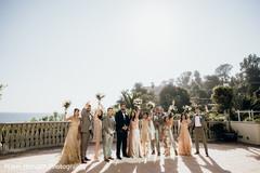 Cheerful bridesmaids and groomsmen during photo shoot