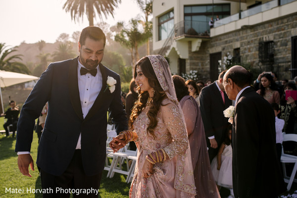 Indian groom holding the maharani's hand during the ceremony
