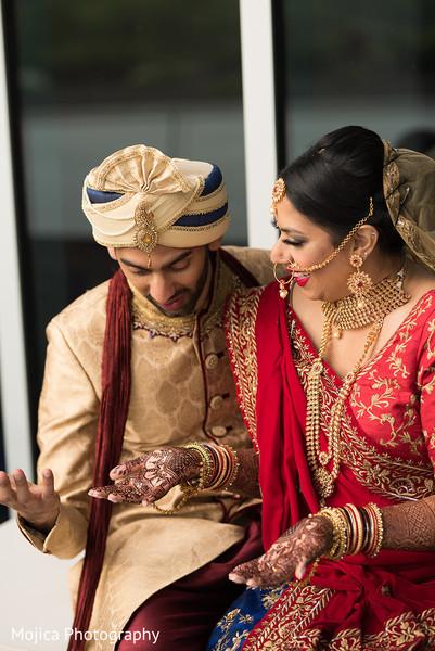 Raja looking at maharani's mehndi