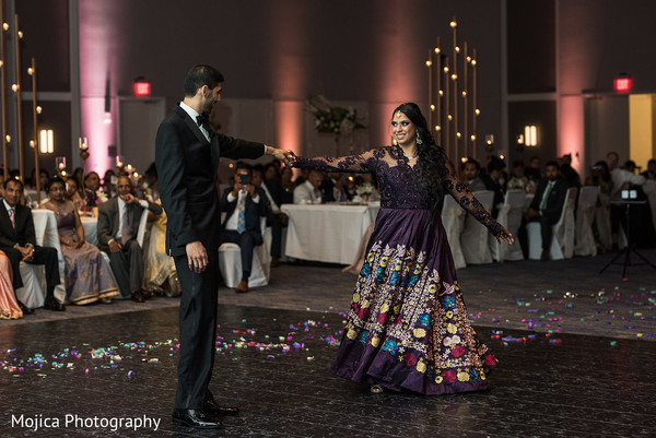 Indian bride and groom having their first dance