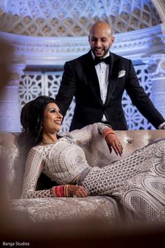 Smiling maharani posing with Raja at the ceremony